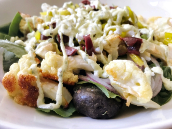 Potato and Roasted Cauliflower Salad with Olives, Feta, and Arugula
